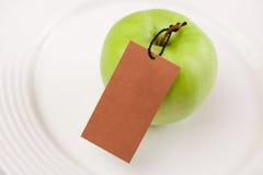 jabłko - zielona etykietka Fotografia Stock