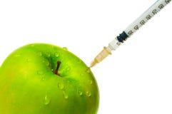 jabłko - zielona strzykawka Obrazy Royalty Free