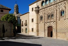 Jabalquinto palace & Cathedral bell tower, Baeza. royalty free stock images