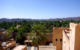 Jabrin Castle View. Inside Jabrin Castle, looking down into the grounds of the fortification, and out over the walls to the fields of date palms and desert Royalty Free Stock Images