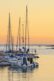 Jachthafenpier bei Sonnenuntergang Lizenzfreie Stockfotos