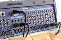 Jack audio connectors is connected to sound mixer Stock Images