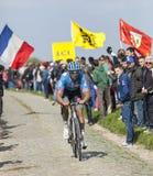 Jack Bauer - Paris Roubaix 2014. Carrefour de l'Arbre,France-April 13,2014:The New Zealand cyclist Jack Bauer from Garmin-Sharp Team riding on the famous Stock Photos
