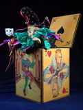 Jack-in-the-Box. Toy jester figure emerging from a box with a Carnivale mask Stock Image