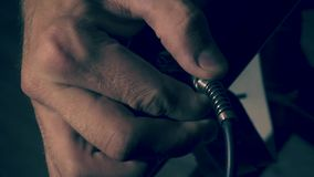 Jack cable to connect in an amplifier. stock footage