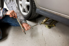Jack and Car. Jacking up a car with the emergency jack stock image