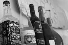 Jack Daniels 3. Many bottles of alcohol and a jack daniels black & white Royalty Free Stock Photo