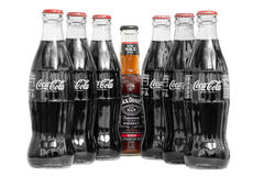 Jack Daniels and coke and coke bottles. Bottle of Jack Daniels and coke and 2 lines of coke bottles in an open triangular shape. Isolated. Taken on 5th October royalty free stock photos