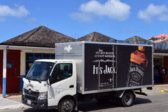 Jack Daniels delivery truck. Marigot, St, Martin - March 2, 2017:  Jack Daniels, the top selling American whiskey in the world, truck parked in front of Gare Royalty Free Stock Photography