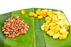 Jack fruit seeds. With split apart and placed on banana leaves in a pannier Stock Image