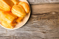 Jack fruit in wooden plate  on old wood background. Stock Photo