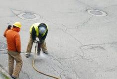 Jack Hammer Crew. City crew repairing asphalt street using a jack hammer Stock Photo