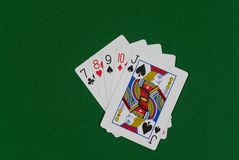 Jack high straight. Poker hand - jack high straight, cards on green cloth Stock Images