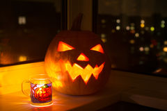 Jack lantern, glowing pumpkin with cup Royalty Free Stock Photos