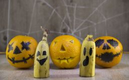 Jack lantern for Halloween of oranges on a wooden background with cobwebs royalty free stock images