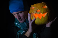 Jack lights the way in halloween night. Using a glowing  pumpkin Stock Photography