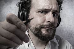 Jack, listening and enjoying music with headphones, man in white Stock Image