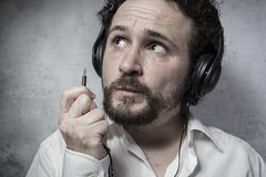 Jack, listening and enjoying music with headphones, man in white Royalty Free Stock Photo
