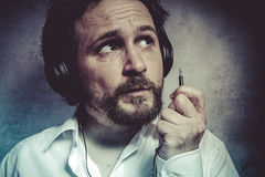 Jack, listening and enjoying music with headphones, man in white Royalty Free Stock Photos