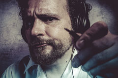Jack, listening and enjoying music with headphones, man in white Stock Photo