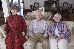 Jack and Lynn Sohm. Two senior citizens with life-sized doll posing on couch in Annapolis, Maryland Stock Photo