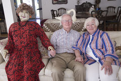 Jack and Lynn Sohm. Two senior citizens with life-sized doll posing on couch in Annapolis, Maryland Royalty Free Stock Images