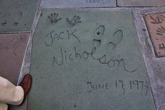 Jack Nicholson's hand- and footprints, Hollywood. At TCL Chinese Theatre, Hollywood. World-famous movie theater in Hollywood that opened in 1927. In front of the royalty free stock images