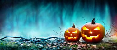 Jack O' Lanterns Glowing At Moonlight In The Spooky Night. Halloween Scene royalty free stock photo