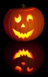 Jack O Lantern. Lit Jack O Lantern for Halloween on black background Royalty Free Stock Photography