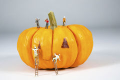 Jack-O-Lantern. Miniature painters and construction crew buiding a Halloween Jack-O-Lantern Stock Photography