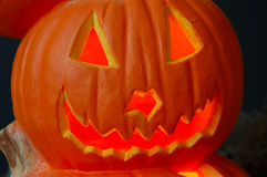 Jack O Lantern. Lighted carved Halloween pumpkin with a jagged happy smile stock photo