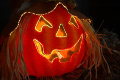 Jack O Lantern. Fiber Optics lighted carved Halloween pumpkin with a jagged happy smile stock photography