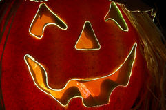 Jack O Lantern. Fiber Optics lighted carved Halloween pumpkin with a jagged happy smile stock photos
