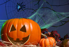 Jack-o-Lantern. Halloween Theme: two pumpkins in hay with spider webs in the background Stock Photo