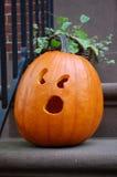 Jack-o-lantern. A surprised jack-o-lantern sitting on a step for Halloween Royalty Free Stock Photos