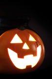 Jack-o'-lantern. Halloween jack-o'-lantern carved from orange pumpkin on black background royalty free stock photography