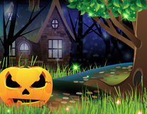 Jack O Lantern and abandoned house. Terrible pumpkin monster on a footpath near a lonely forest lodge Royalty Free Stock Images