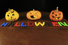 Jack o'lantern above halloween text Stock Image