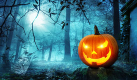 Jack o lantern in blue moonlight Stock Photography