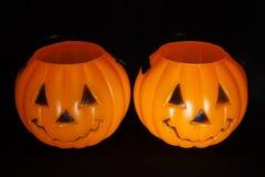 Jack-O-Lantern Buckets. Two jack-o-lantern candy buckets Stock Images