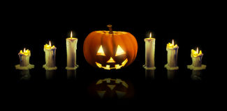 Jack'o'lantern and  candles Stock Images