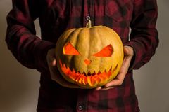 Jack`o`lantern carved pumpkin in hands stock photography