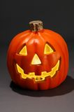 Jack-O-Lantern (With clipping path). Jack-O-lantern with candle against dard background royalty free stock photo