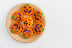 Jack-o'Lantern Cookies. Plate of Halloween cookies with a cupcake Stock Image