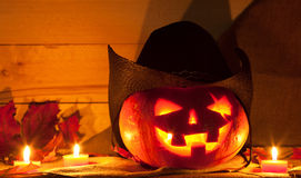 Jack O' Lantern. In a cowboy hat on the table. Pumpkin carved for Halloween Royalty Free Stock Photography