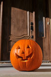 Jack o-lantern by the door Royalty Free Stock Photos