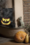 Jack o' lantern in fireplace Royalty Free Stock Images