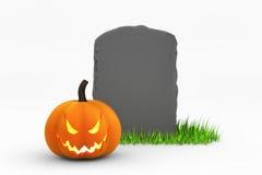 Jack-O-Lantern and Gravestone Royalty Free Stock Images
