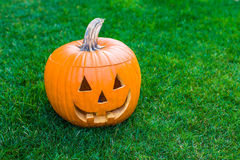 Jack-o-lantern on green grass Royalty Free Stock Photos