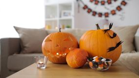 Jack-o-lantern and halloween decorations at home stock video footage